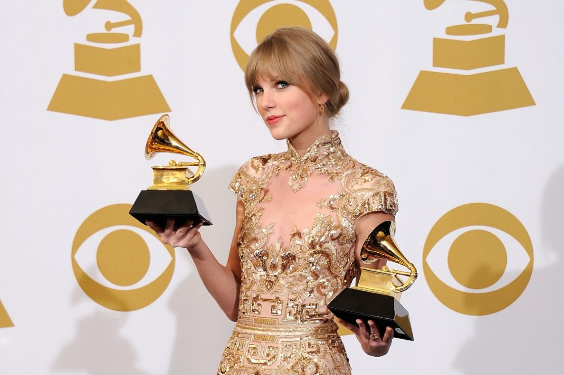 """LOS ANGELES, CA - FEBRUARY 12:  Singer/songwriter Taylor Swift, winner of the GRAMMYs for Best Country Song with """"Mean"""" and Best Country Solo Performance for """"Mean"""", poses in the press room at the 54th Annual GRAMMY Awards at Staples Center on February 12, 2012 in Los Angeles, California.  (Photo by Kevork Djansezian/Getty Images)"""